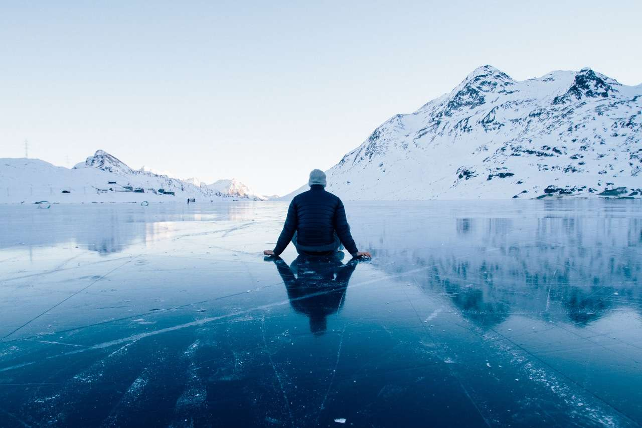 Guy Sitting On Ice Lake