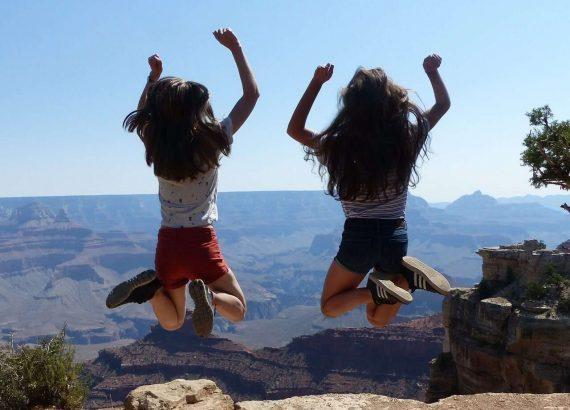 Girls Jumping Near Grand Canyon,USA