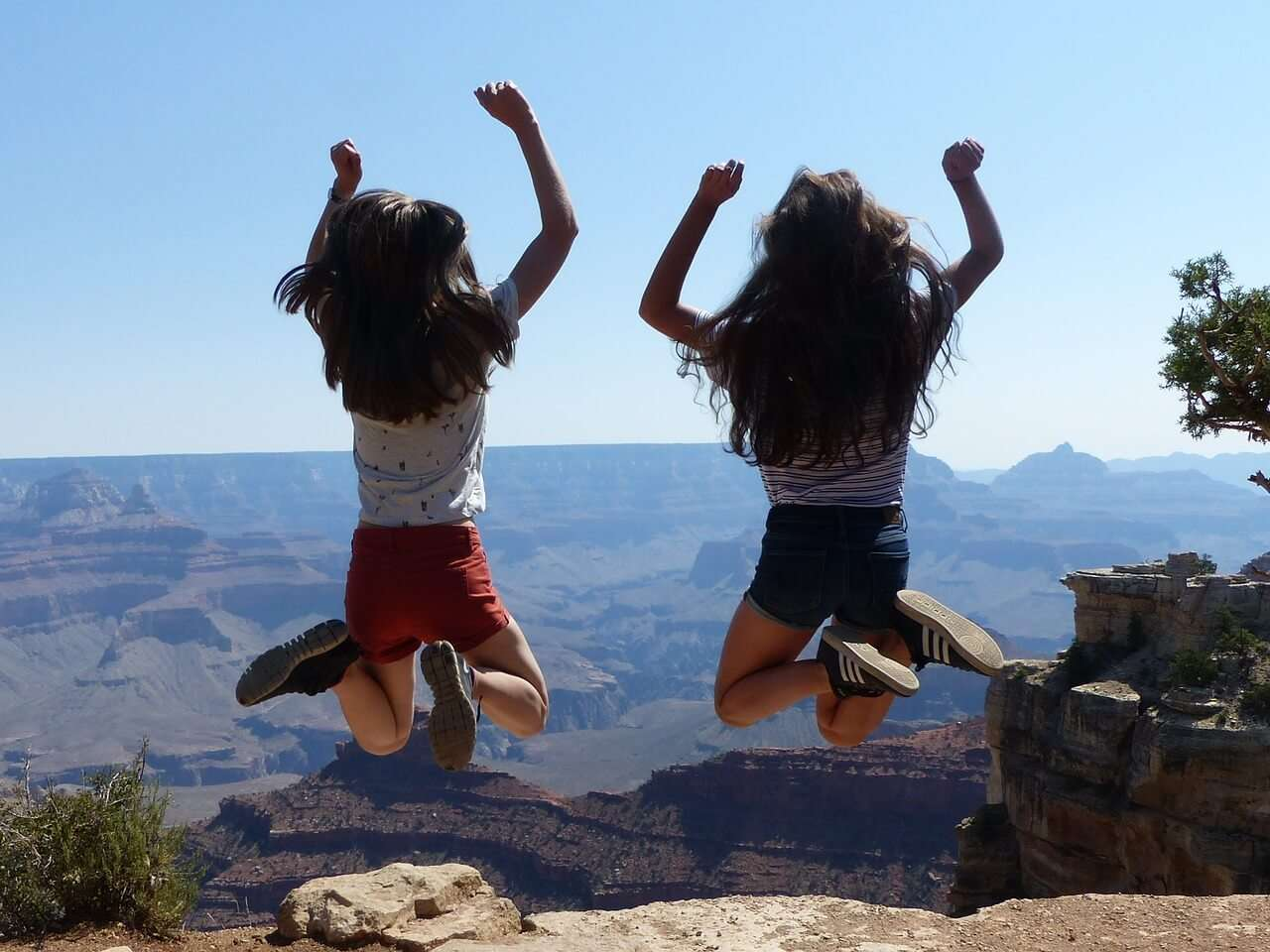 Girls Jumping Near Grand Canyon,USA