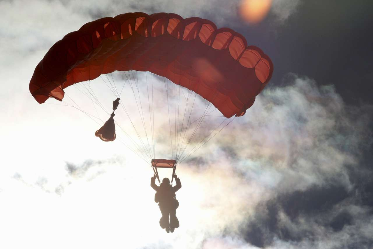 Man Coming Down By Parachute